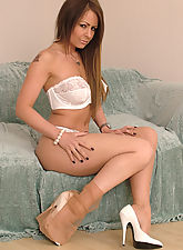 Leggy brunette in tan stockings and white high heels