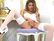 Charmane Starr in white lingerie and heels fingering her pussy