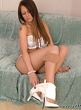 All white lingerie and gorgeous matching stilettos on this honey