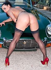 nylon stockings, Chloe posing with a vintage car in classic Harmony Points and stilettos