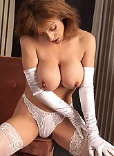 You wont be disappointed when viewing Gabrielle in sexy white lingerie and nylons