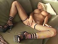 Big boobed blonde in fencenet stockings and heels